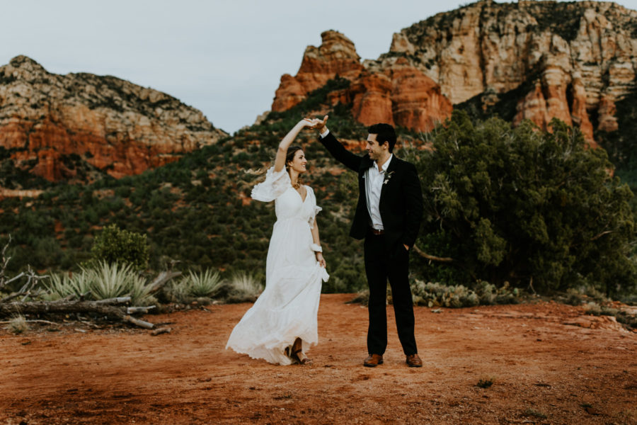 groom spinning bride in sedona