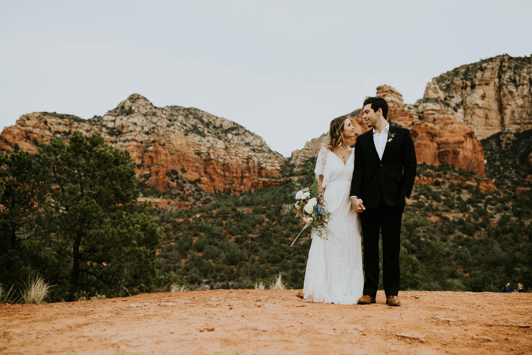 bride and groom holding hands sedona elopement