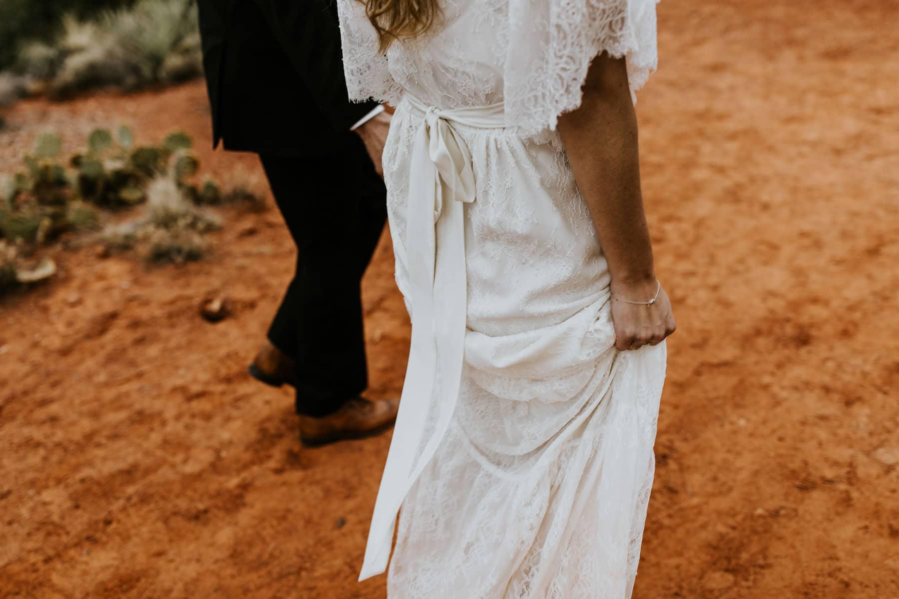 bride and groom walking in sedona