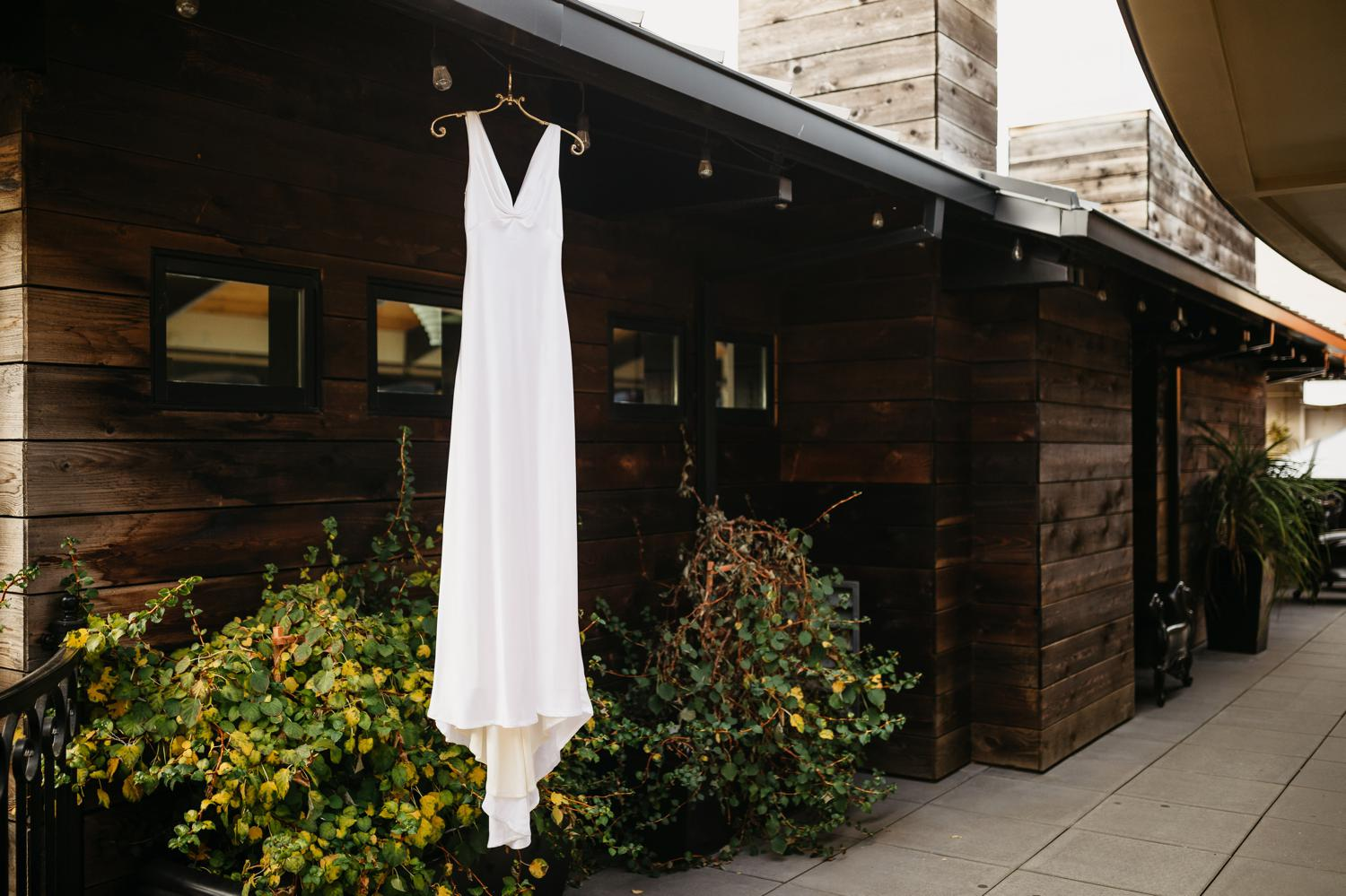 wedding dress hanging at hotel ballard