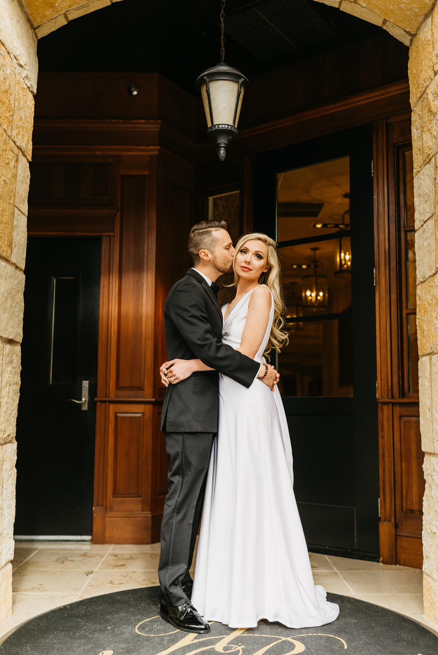 bride and groom in hotel ballard doorway
